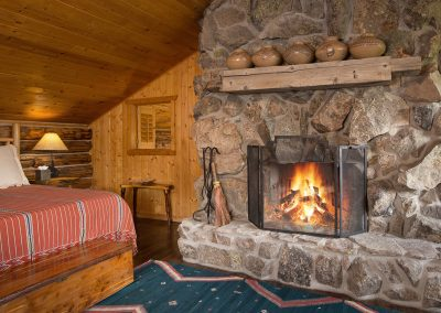 cabin-onthelake-bedroom-fireplace