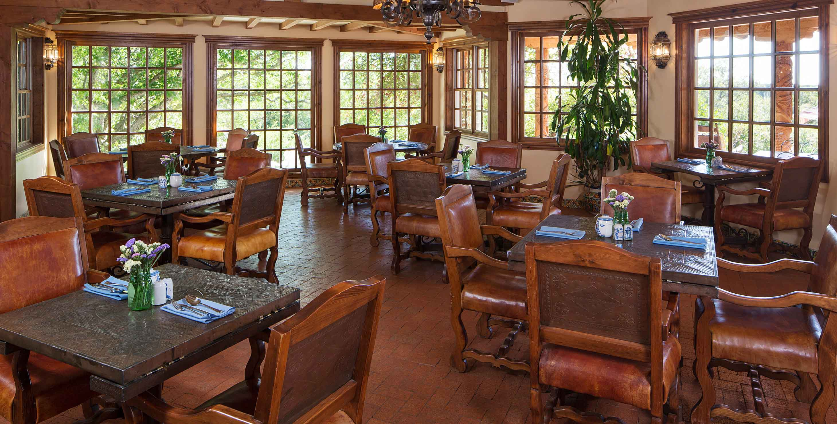 Tables and chairs with in a dining room with abundant natural light