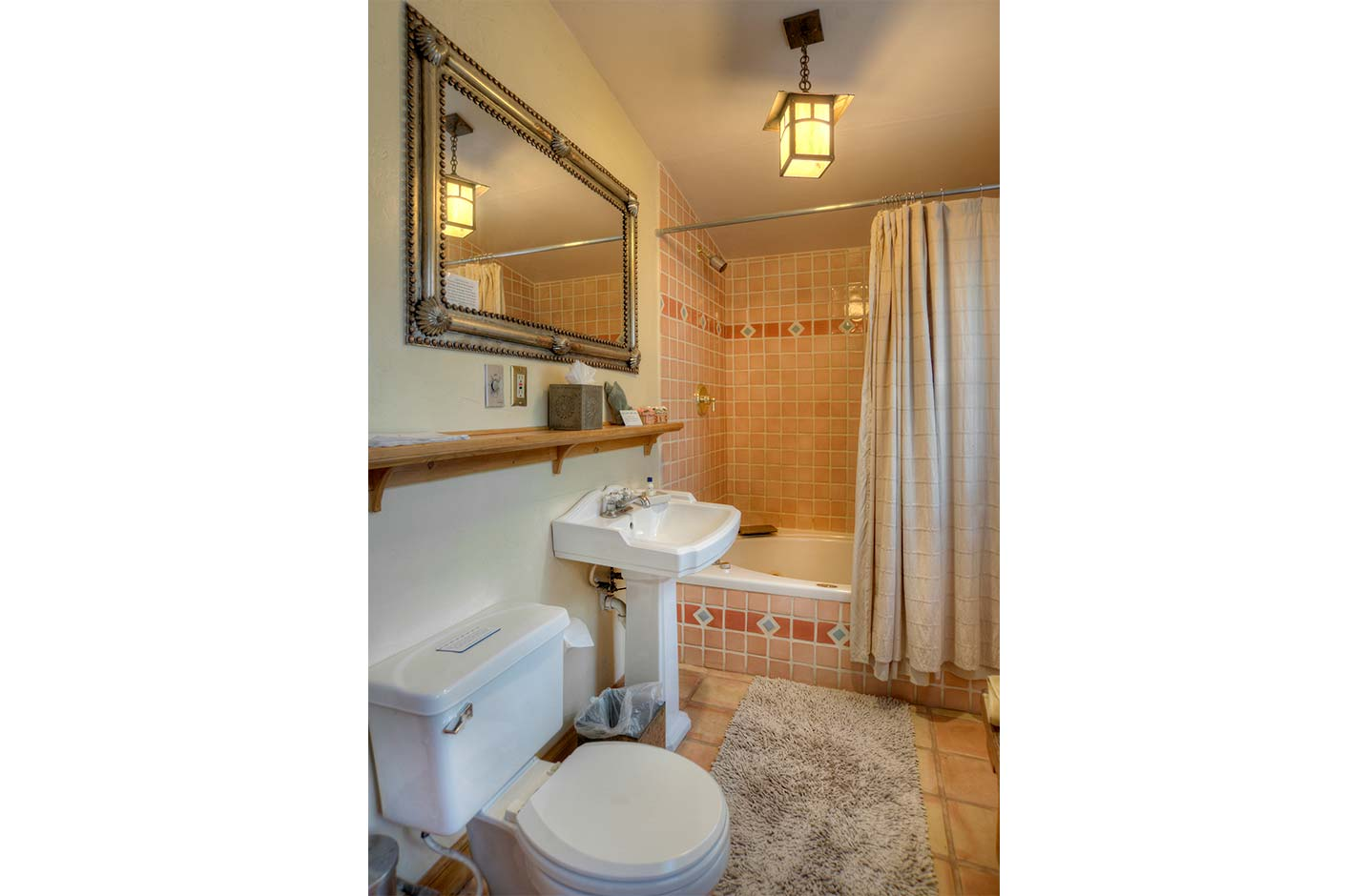 Bathroom with a tiled shower and tub