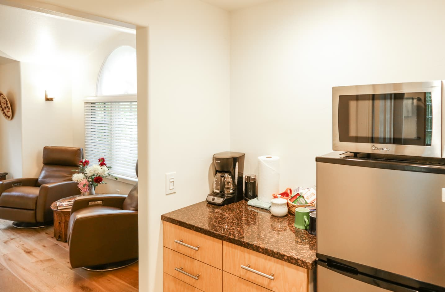 Kitchenette with coffee maker and fridge in the Garden Room