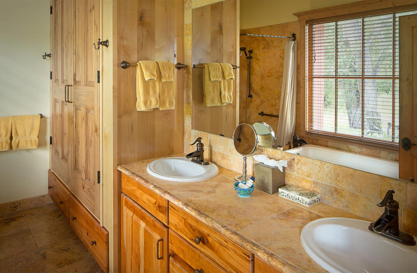 Bathroom with double vanity sinks and a walk-in shower