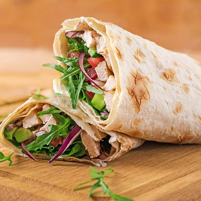 Chicken Wrap on a wooden cutting board
