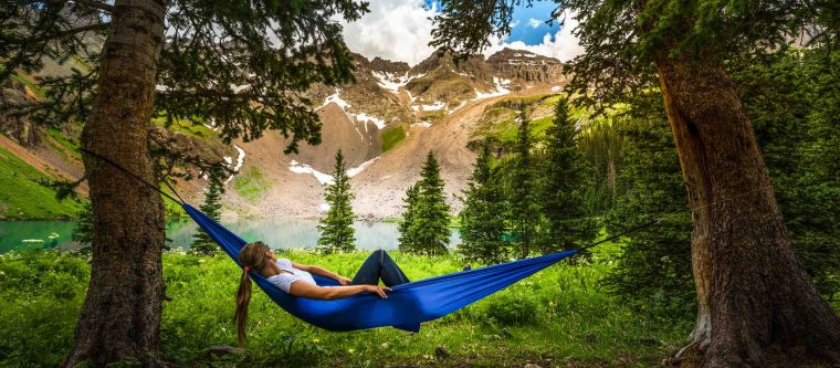 Woman lounging on a hammock in Colorado