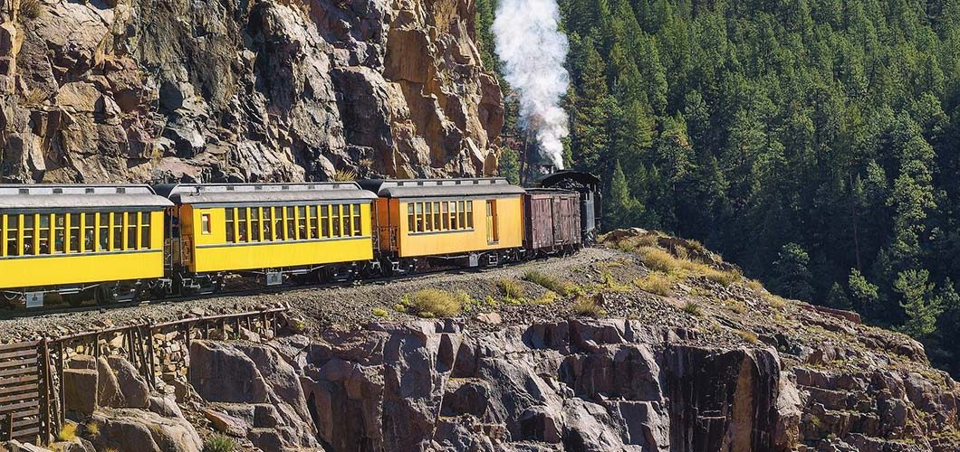 Historic steam train on a mountain pass